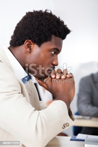 1053499704 istock photo African Businessman Looking At Laptop 460807529