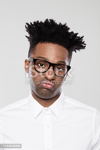 istock African businessman looking bored 1144546394