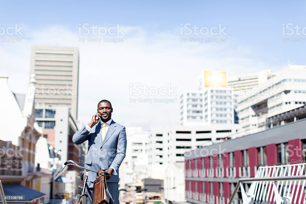 African businessman on the phone having a conversation. stock photo
