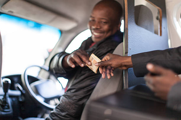 African businessman paying the taxi driver stock photo