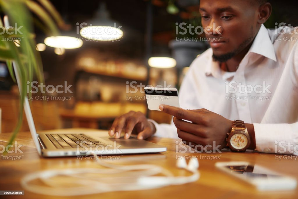 African businessman paying with credit card stock photo