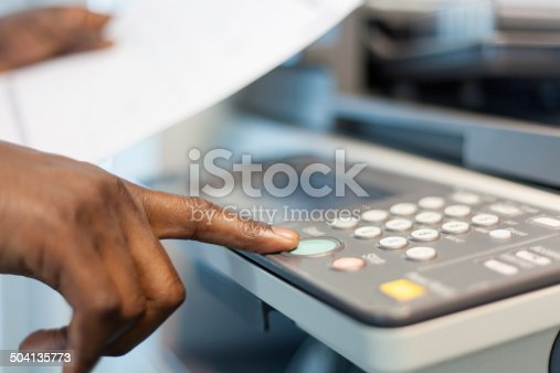istock African businessman pressing the start button to print. 504135773