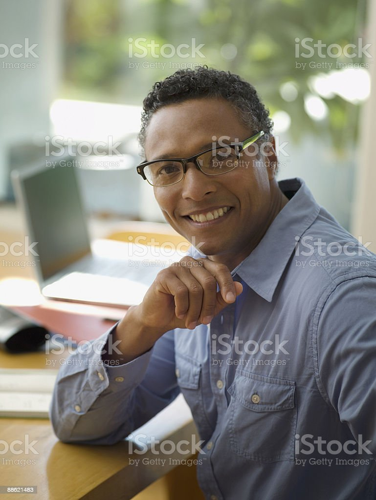 African businessman sitting at desk royalty-free stock photo
