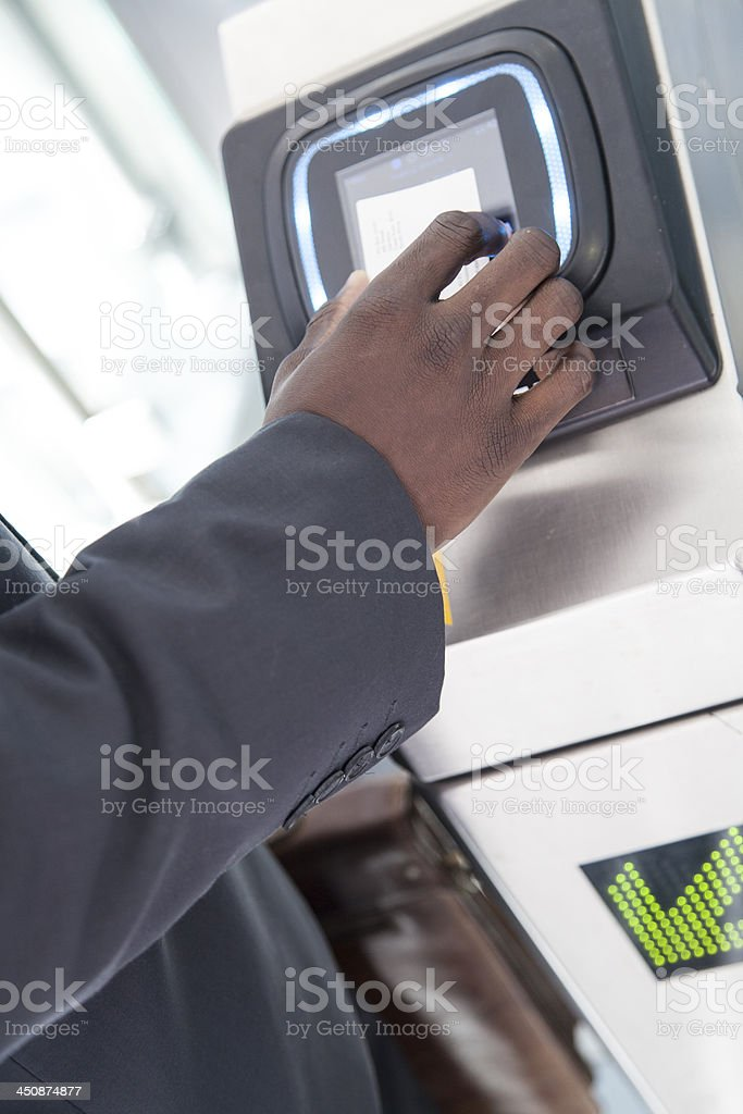 African businessman using his access card. stock photo