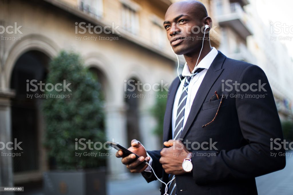 African businessman using mobile phone stock photo