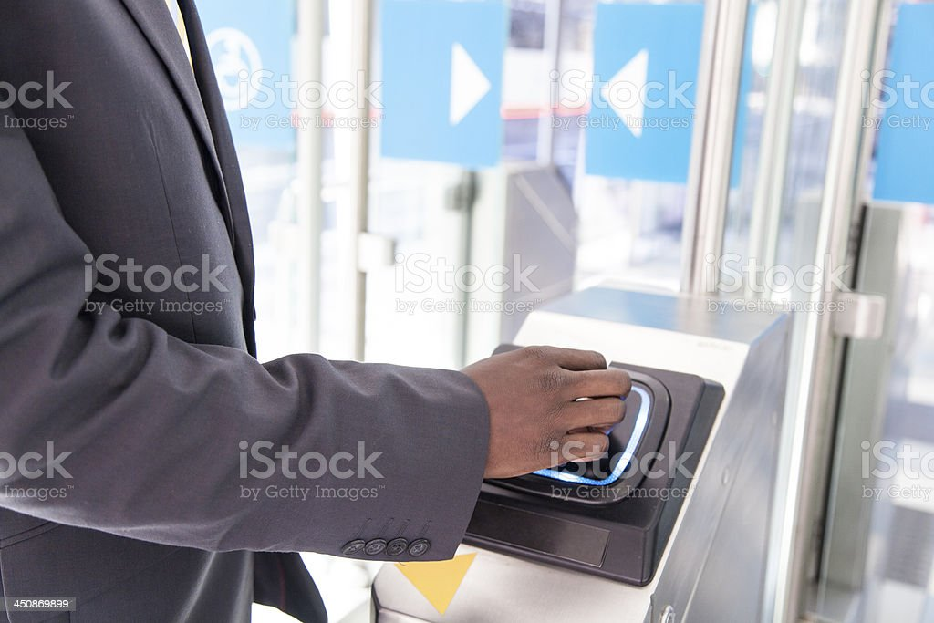 African businessman waiting for the doors to open. stock photo