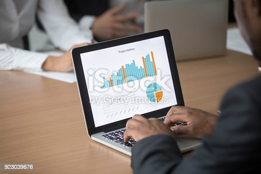 istock African businessman working on computer analyzing project statistics on screen 923039676