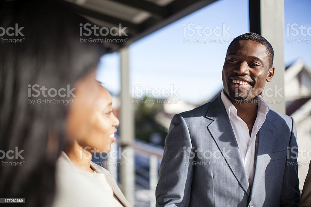 African businessman working with colleagues royalty-free stock photo
