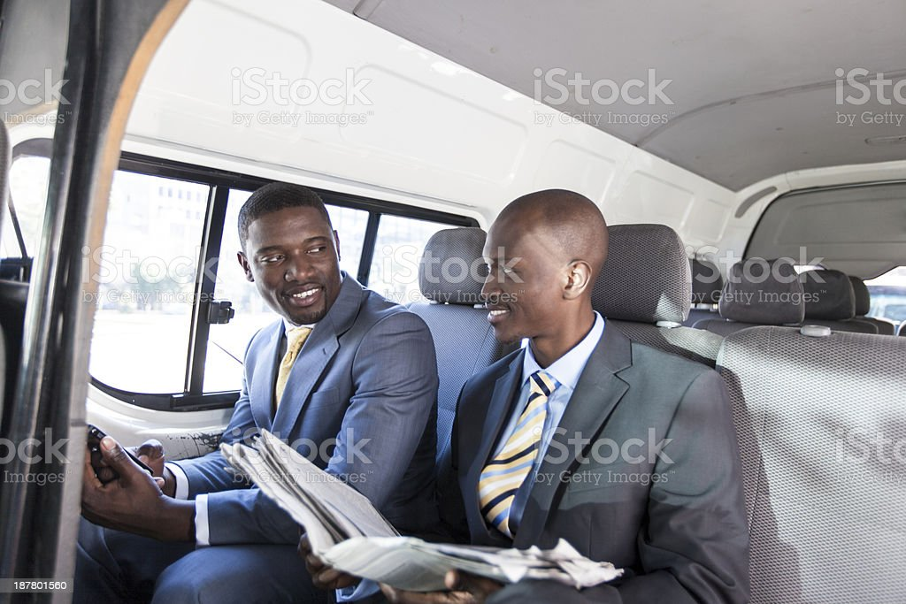 African Businessmen having a conversation in the taxi. royalty-free stock photo
