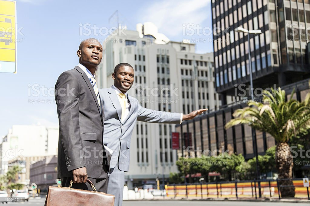 African businessmen stopping the bus stock photo