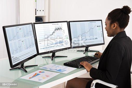 istock African Businesswoman Analyzing Data 584204444
