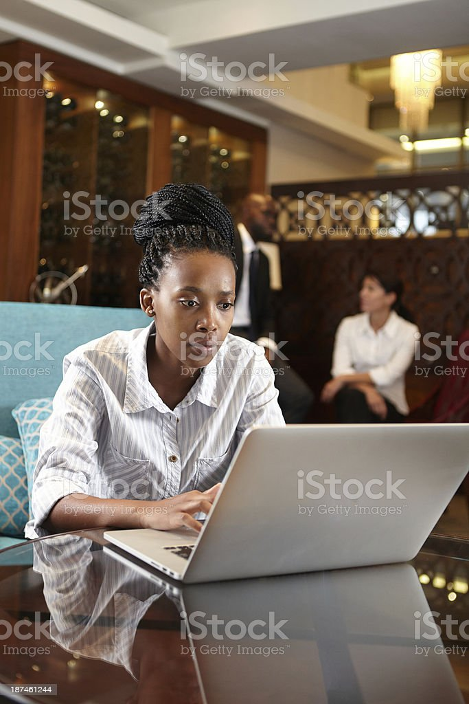 African businesswoman oncentrating hard on work at hand stock photo