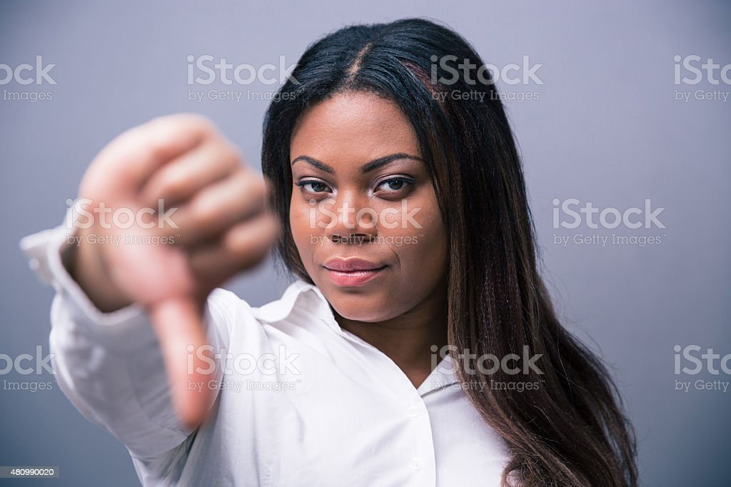 African businesswoman showung thumb down stock photo