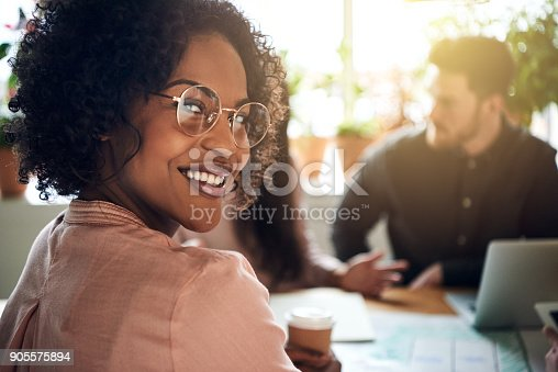 istock African businesswoman smiling during a boardoom meeting in an office 905575894
