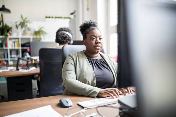 African businesswoman working at her desk stock photo