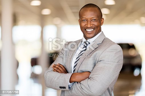 istock african car sales consultant with arms folded 517087756
