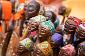African tribal art for sale at a market stall. This artwork is generic and widely available across markets in South Africa.