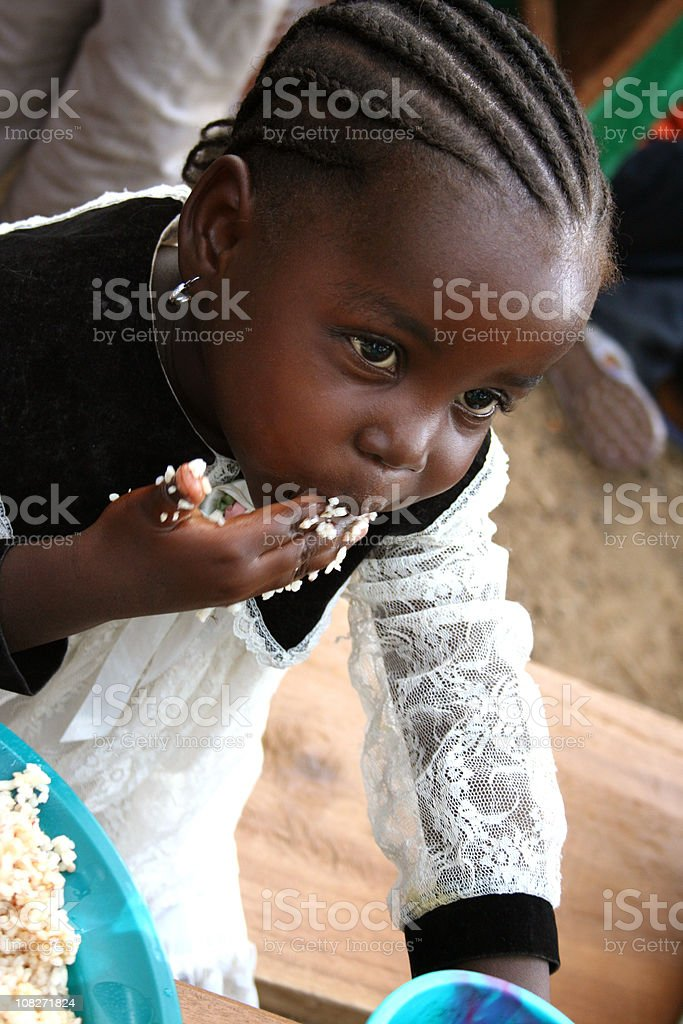 African Child Eating royalty-free stock photo