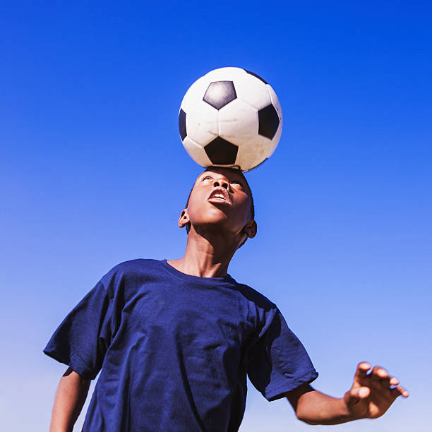 African child heading the football picture id471689021?b=1&k=6&m=471689021&s=612x612&w=0&h=afoo4 n5be2yct2peagw81cwmbhaa69tunq1b2vu0fs=