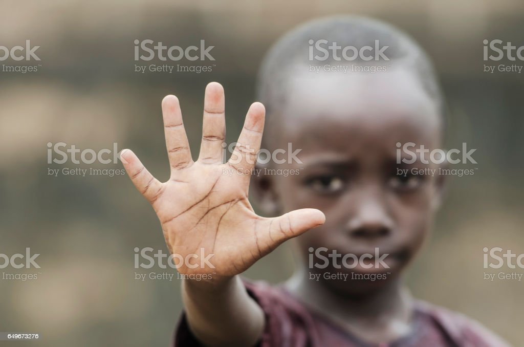 African Child Says STOP! To Racism and to War! stock photo