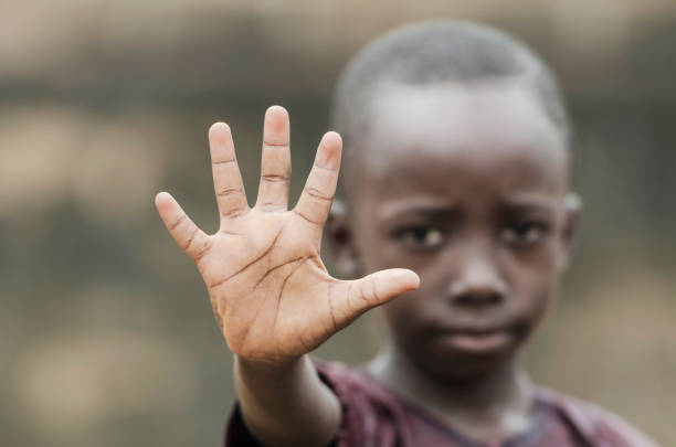 african child says stop! to racism and to war! - african culture stock photos and pictures