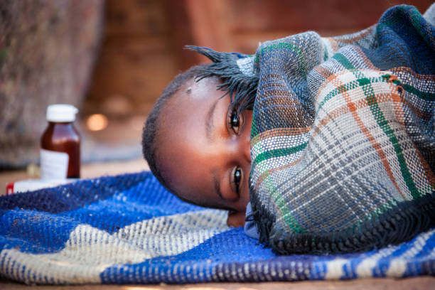 african child toddler sick with malaria