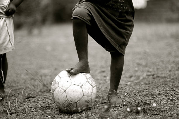 African Child with Soccer Ball stock photo