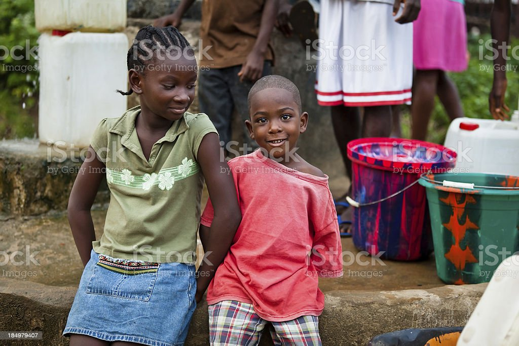 African Children by Water Pump royalty-free stock photo