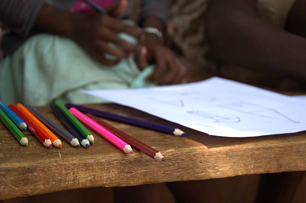 african children drawing with coulerful pencils stock photo