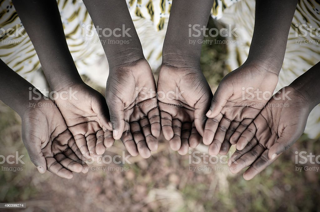 African Children Holding Hands Cupped To Beg Help Disease stock photo