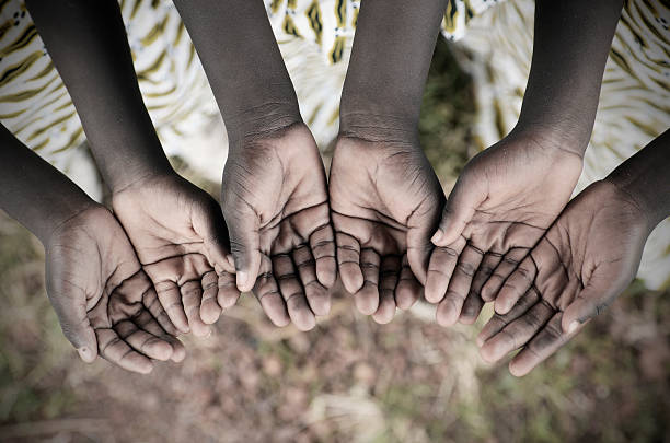 african children holding hands cupped to beg help disease - democratic republic of the congo stock photos and pictures
