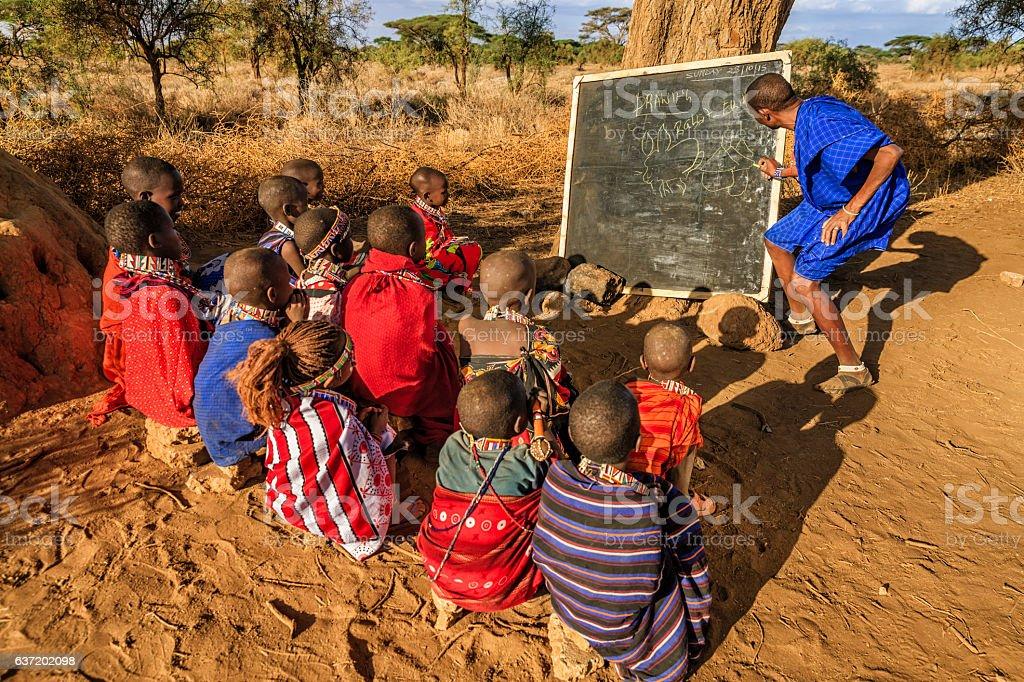 African children in the school under tree, Kenya, East Africa stock photo