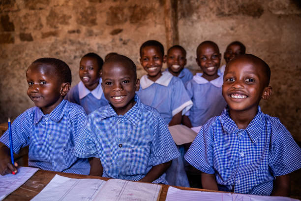 African children learning during English class, orphanage in Kenya stock photo