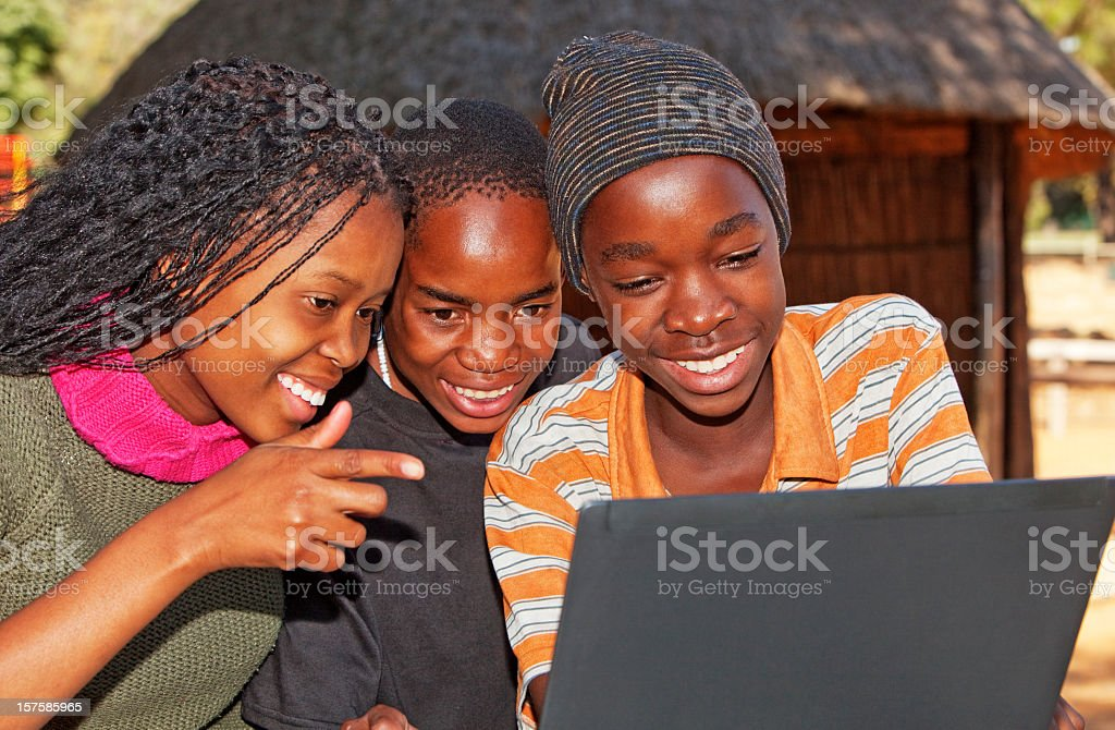 African children looking at Laptop stock photo