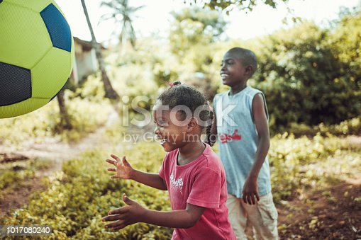 African children playing football in the village