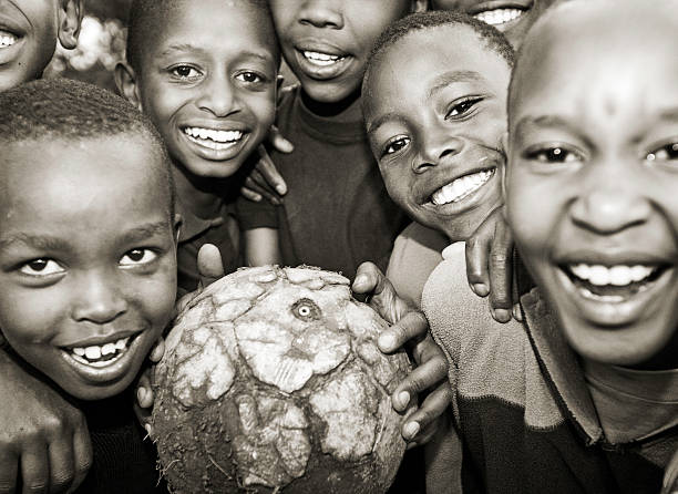 African Children PLaying Soccer / Football stock photo