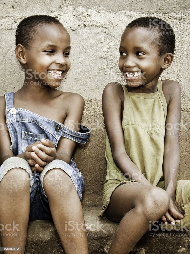 African Children Smiling with Missing Teeth stock photo
