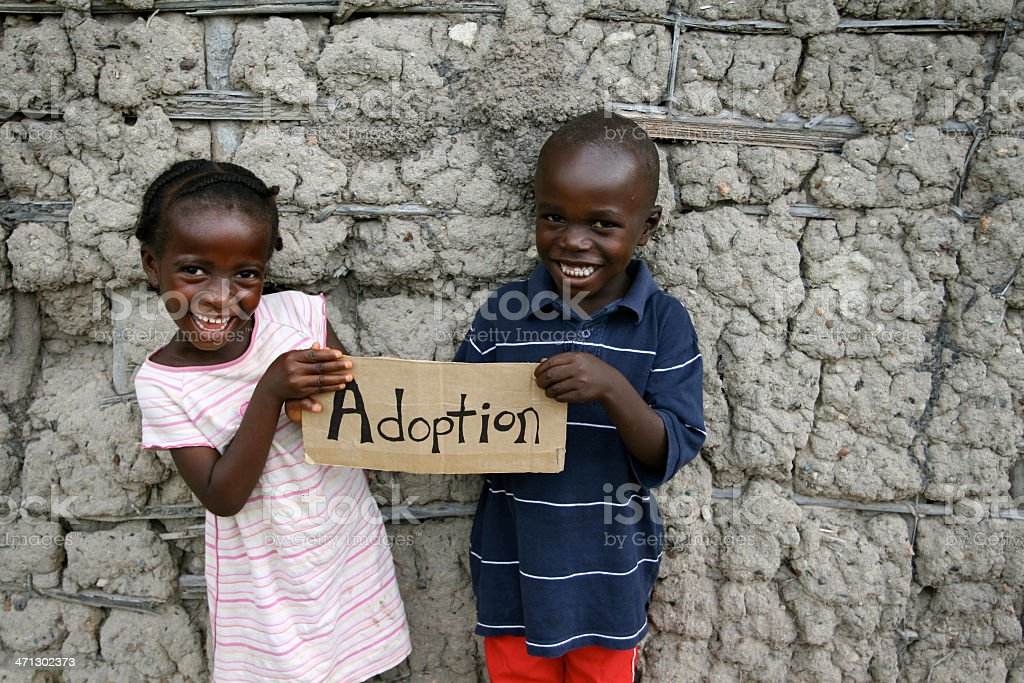 African Children with Adoption Sign royalty-free stock photo