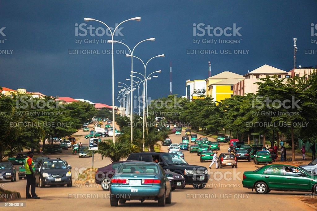 African City Traffic Under Dark Clouds Abuja Nigeria Stock