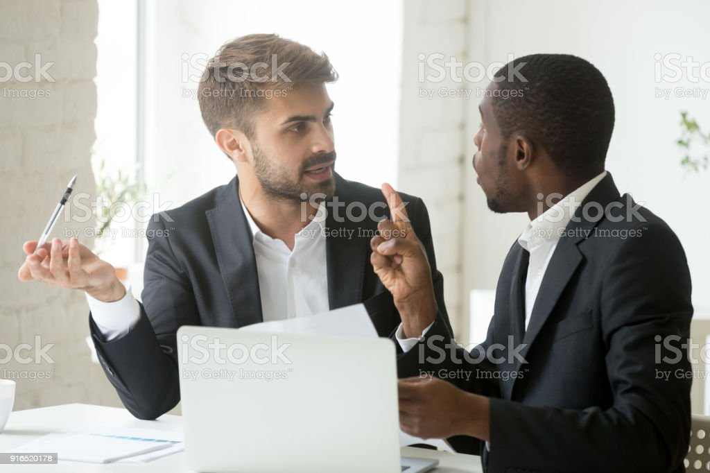 African client having claims about document disagreeing with caucasian partner stock photo
