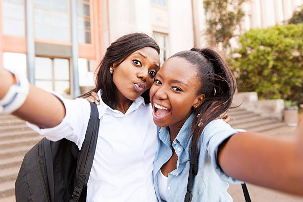 african college friends taking selfie together stock photo