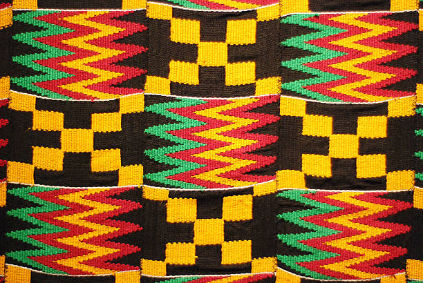 african colored pattern fabric background - african culture stock photos and pictures
