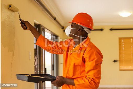 835790922istockphoto african construction worker painting the wall 506677798