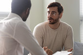 istock African counsellor sitting in front of patient listens his complaints 1252926473