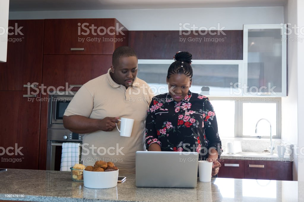 African couple going over their finances stock photo