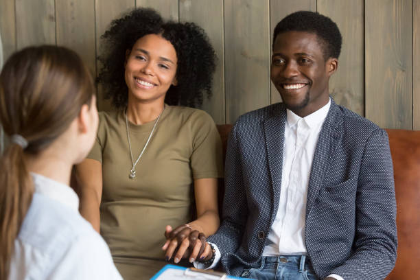 African couple happy to hear good news from doctor counsel stock photo