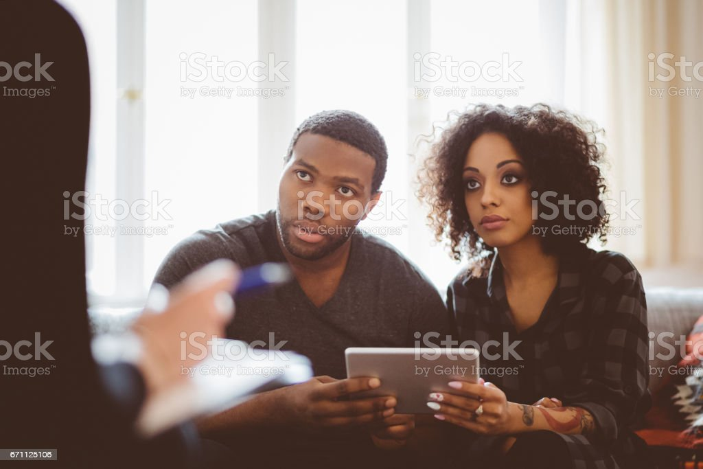 African couple in meeting with financial advisor stock photo
