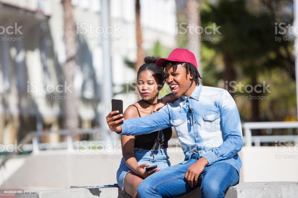 African couple taking a selfie picture stock photo
