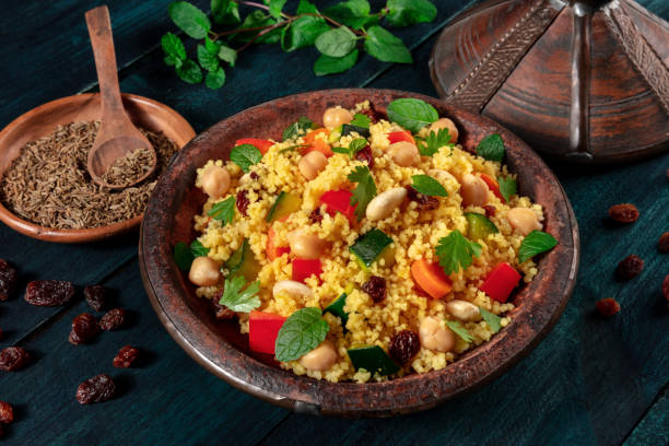 African couscous in the tagine, with spices and herbs stock photo