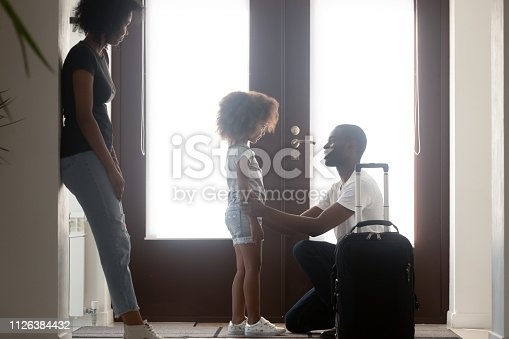 istock African dad talking to upset mixed-race kid daughter saying goodbye 1126384432